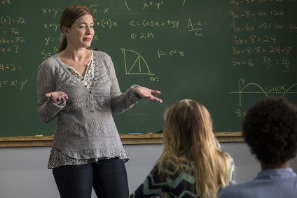 Female teacher teaching in class